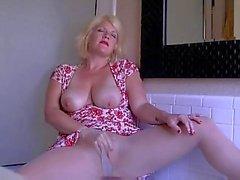 Busty blonde teasing in pantyhose