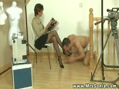 Lady Sonia makes young sub lick her legs