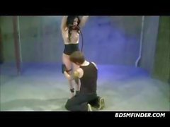 Hot brunette gets suspended, blindfolded and ball gagged