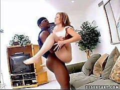 curvy pale brunette rides on black bull