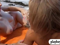 Two babes in bikini blowjob and pounded by the shore