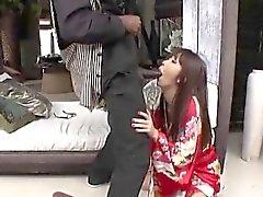 Asian babe deep throats cock