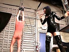 Hanging slave is being whipped