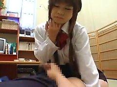 Pigtailed Japanese schoolgirl in white panties fingers her