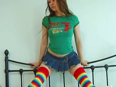 Flexible teen poses naked in her bedroom