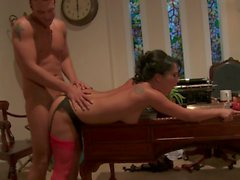 Horny Asian MILF rides young stud cowgirl style on the sofa