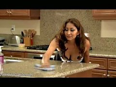 Exotic milf Jesse banging a younger guy in the kitchen