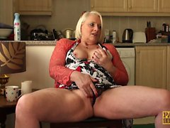 Granny submissive rubs her box in kitchen