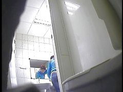 Girls peeing in a rest room-2
