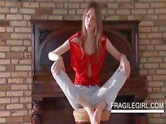 Horny teen strips sensually on a chair