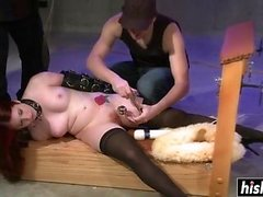 Two guys enjoy torturing a sweet babe