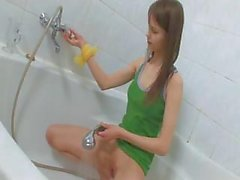 Thin busty girl peeing on a toilet