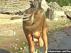 Teen Linda masturbating on the beach