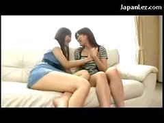 2 Asian Girls Kissing Passionately Sucking Tongues On The Couch