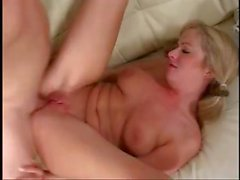 Cute blonde in pigtails goes down on his cock and then rides it