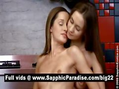 Adorable blonde and brunette lesbians kissing and getting naked in a three way lesbian orgy