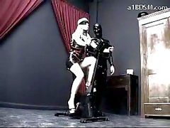 Blindfolded Girl In Pvc Dress Cycling Getting Her Tits Rubbed Spanked In The Dungeon