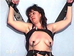 Bondage mature tart with pins on tits
