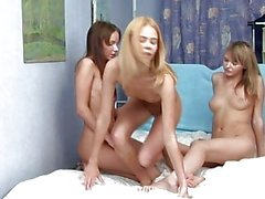Amazing brunette and blonde lesbians fingering and licking pussy in a three way lesbian orgy