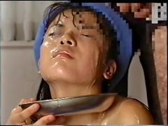 Icy hot bukkake party leaves Japanese teen with her face greased in man seed