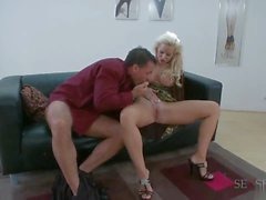 Busty blonde rides hard cock with her ass