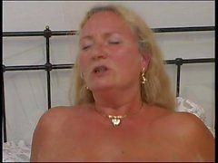 German mature gets fucked on the bed