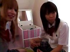 Adorable Japanese schoolgirls enjoying an exciting lesbian