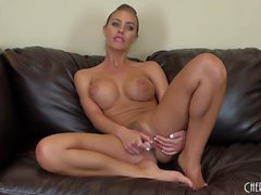 Slender blonde milf with big boobs Nicole Aniston has fun with a dildo