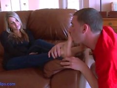 Cute blond get feet worshipped on her couch