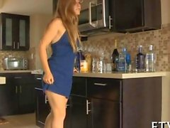 Petite blonde plays with a bottle