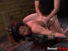 Bound slave gobbles dick