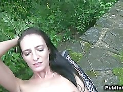 Slim brunette amateur fucks outdoors