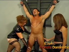 Naughty well-hung stallion gets dominated by two horny brunette mistresses