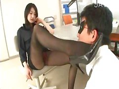 Slutty asian in pantyhose giving footjob