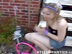 18yo Kitty playing with a puzzle in a miniskirt