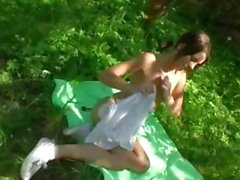 Brunette Rosa masturbates with a toy outside in the forest