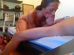 obedient whore doing a blowjob