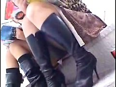 Sensual Asian girl in black boots shows off her white panti