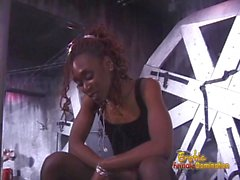 Slim ebony dominatrix pleasures a horny dude in the dungeon