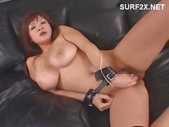 Giant boobs on this Asian girl as she gets accosted by vibrators