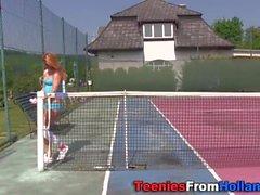 Teen rubs on tennis court