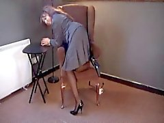 British slut Kayla plays with herself in black hold-ups