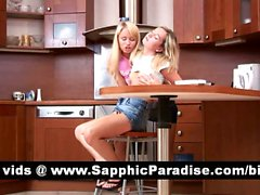 Adorable blonde lesbos kissing and fingering pussy in the kitchen and having lesbo love