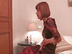 Scrawny grandma fucks herself with big dildo