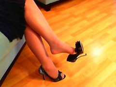 Pantyhose dangling foot tease