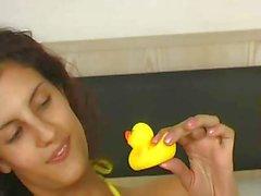 girl showing her yellow bikini