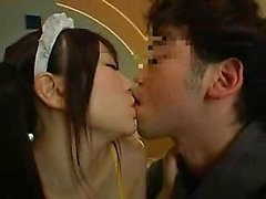 Pigtailed Oriental maid in stockings blows and strokes two