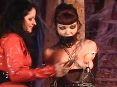 Goth dominatrix mistreats her lesbian slave