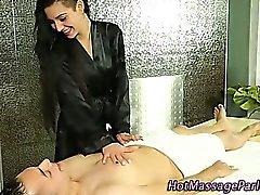 Masseuse tugs dick under towel