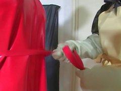 Bizarre rubber enema servant 2 of 5
